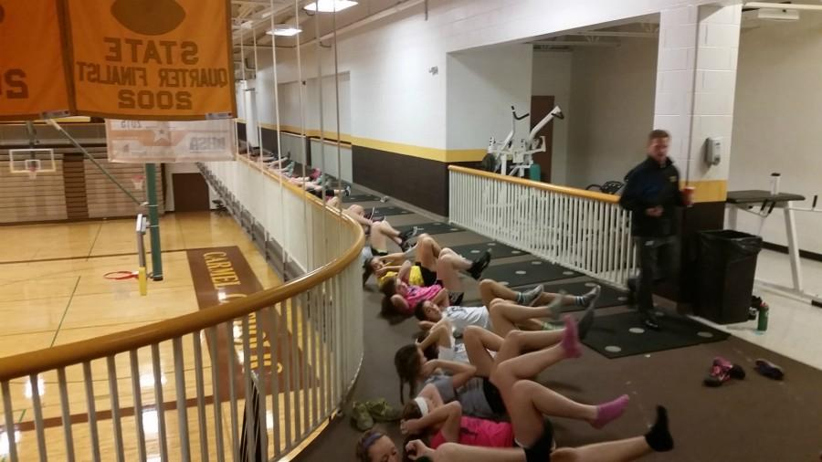 Girls soccer team breaking a sweat at morning workouts.