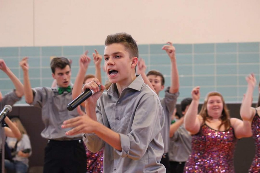 Junior Justin Eberhardt spitting fire during the winter pep rally.