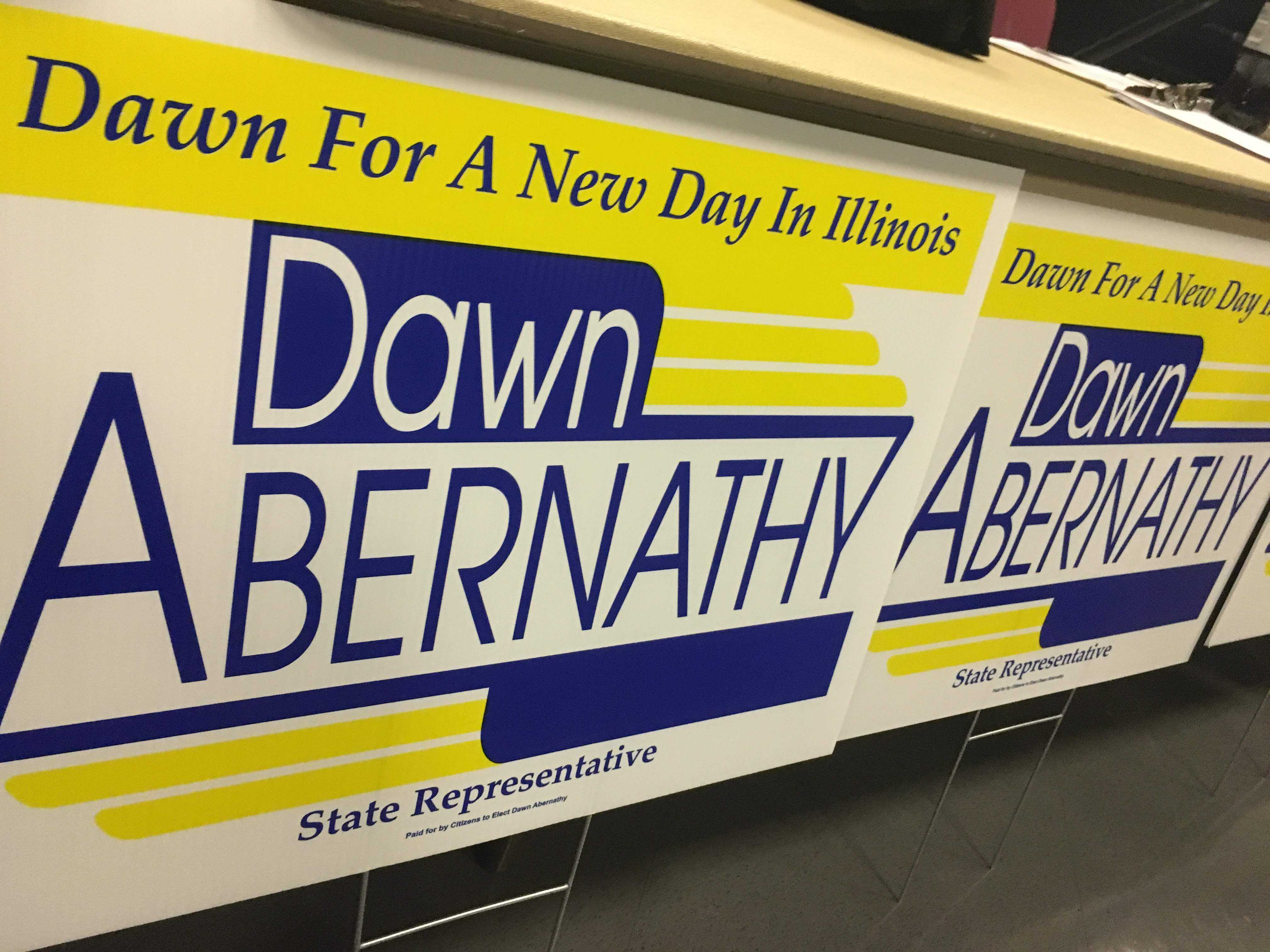 A+series+of+signs+from+the+Abernathy+campaign.