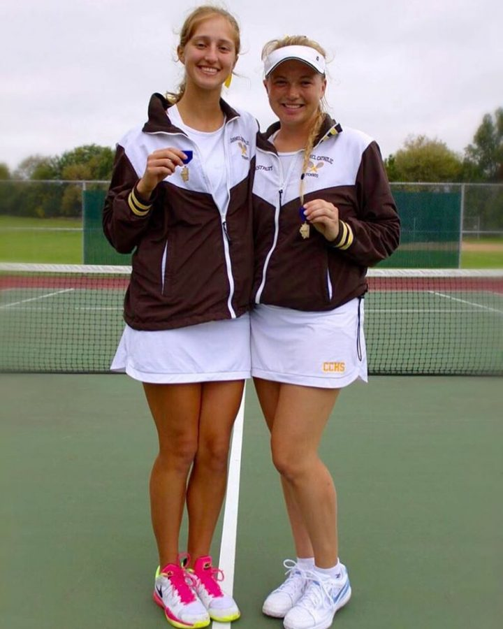 Seniors Marie Kapelevich and Karina Falkstrom show off their Sectional win swag.