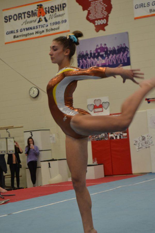 Freshman Isabella Kropiewic performs her floor routine at the Barrington Tri meet last Saturday night at Barrington High School