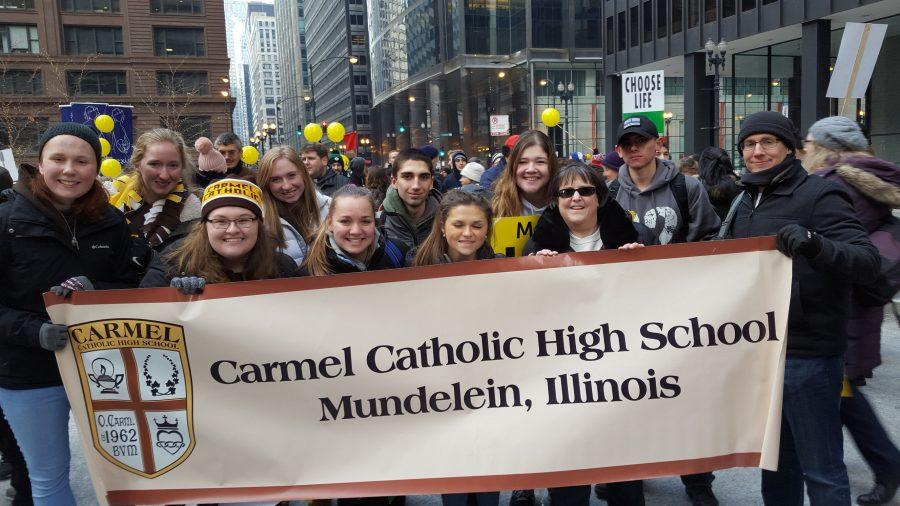 Students+and+faculty+march+through+the+streets+of+Chicago