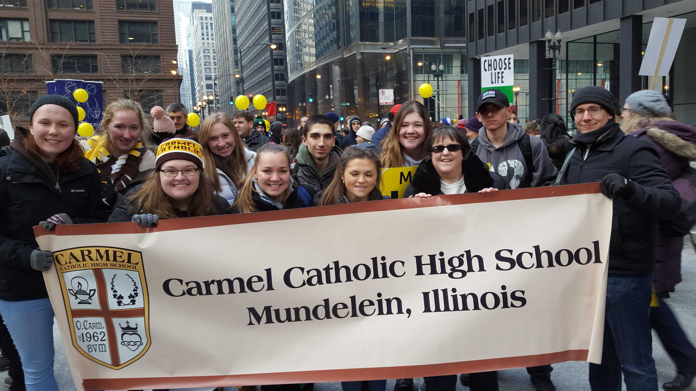 Students and faculty march through the streets of Chicago