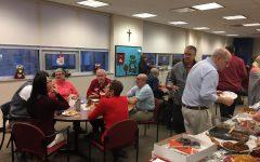 Faculty enjoying the St. Nick breakfast.