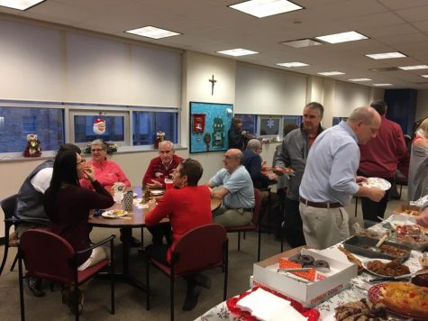 Faculty enjoying the St. Nick breakfast.