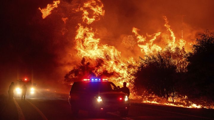 Flames+above+vehicles+on+Highway+162+as+the+Bear+Fire+burns+in+Oroville%2C+Calif.%2C+on+Wednesday%2C+Sept.+9%2C+2020.+