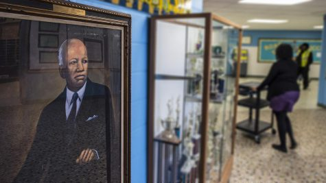A portrait of Carter G. Woodson hangs in the hallway at Carter G. Woodson South Elementary School in Chicago.